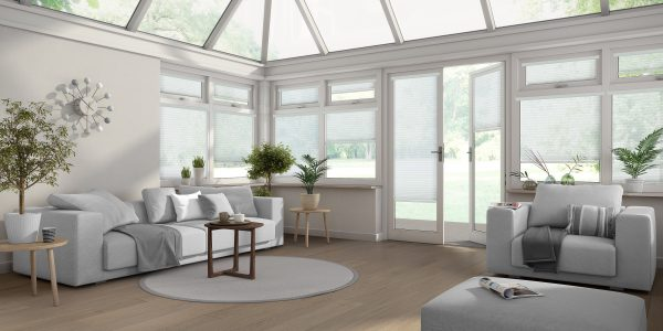 Living room in conservatory with white Intu blinds